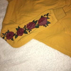 Zumiez Tops - yellow hoodie with roses